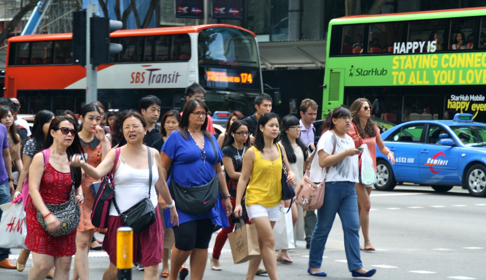 Singaporeans walking on Orchard road